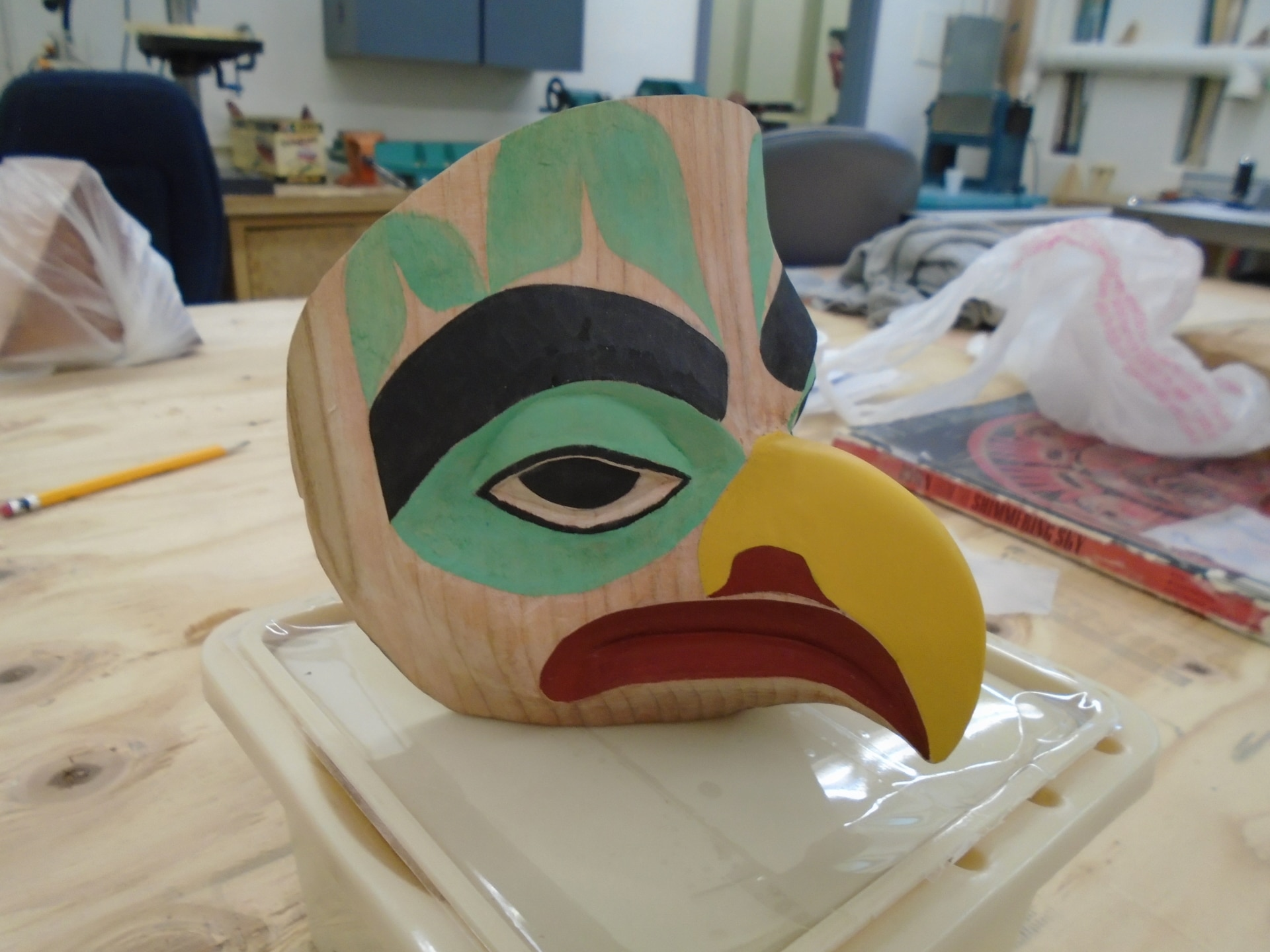 A carved mask being created in the Lemon Creek Correction Center