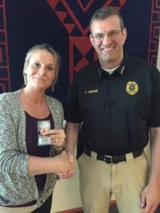 Reentry Hero Karmen Moreno McVey shakes hands with JPD Polich Chief Johnson and receives her Challenge Pin.