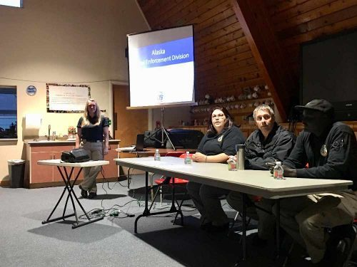 Juneau Pretrail Enforcement Officers presenting information to the Juneau Reentry Coalition at a Community Meeting