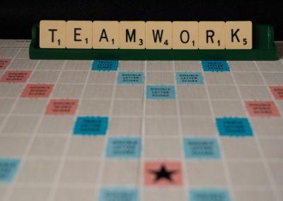 Juneau Reentry Coalition Leadership illustrated as Teamwork on a Scrabble board