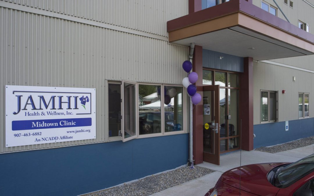 JAMHI Health & Wellness, Inc. Midtown Clinic's sign and entryway on the day of their grand opening in June 2018.